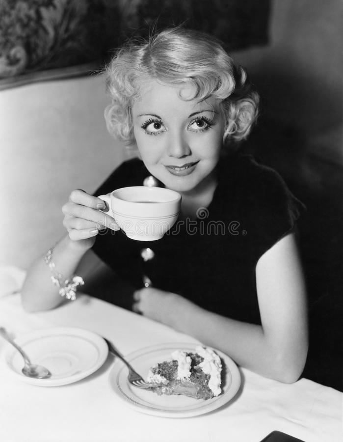 Portrait of woman having pie and coffee royalty free stock image