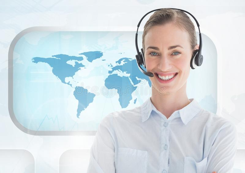 Portrait of woman in headset standing against world map royalty free stock image