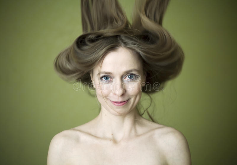 Woman with flying hair stock images