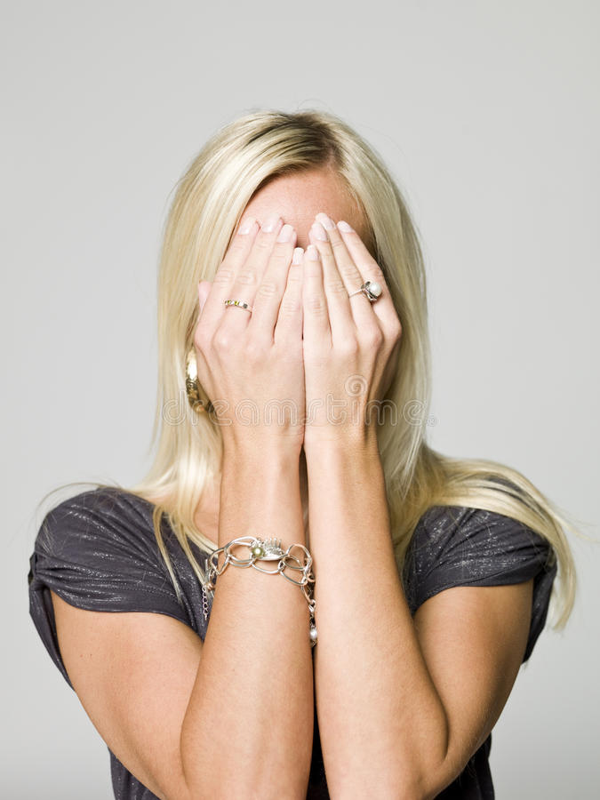 Download Portrait Of A Woman Hiding In Her Hands Stock Photography - Image: 10873542