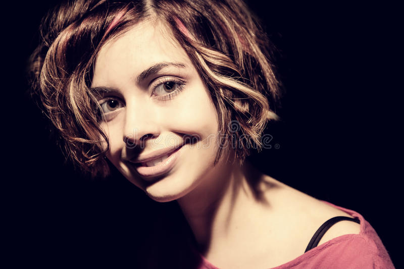 Portrait of woman in high contrast lighting royalty free stock photography