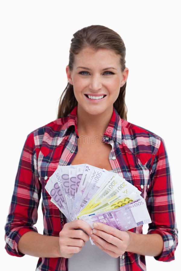 Portrait of a woman holding bank notes