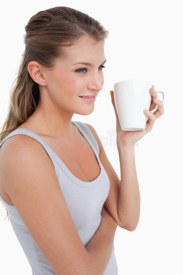 Download Portrait Of A Woman Holding A Cup Of Tea Stock Photos - Image: 22693923