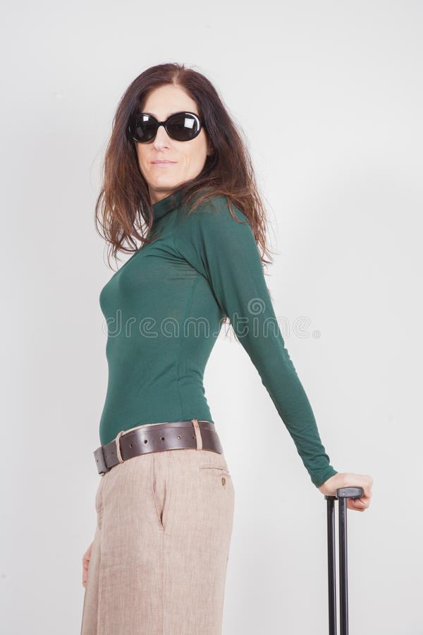 Portrait of woman holding suitcase royalty free stock image