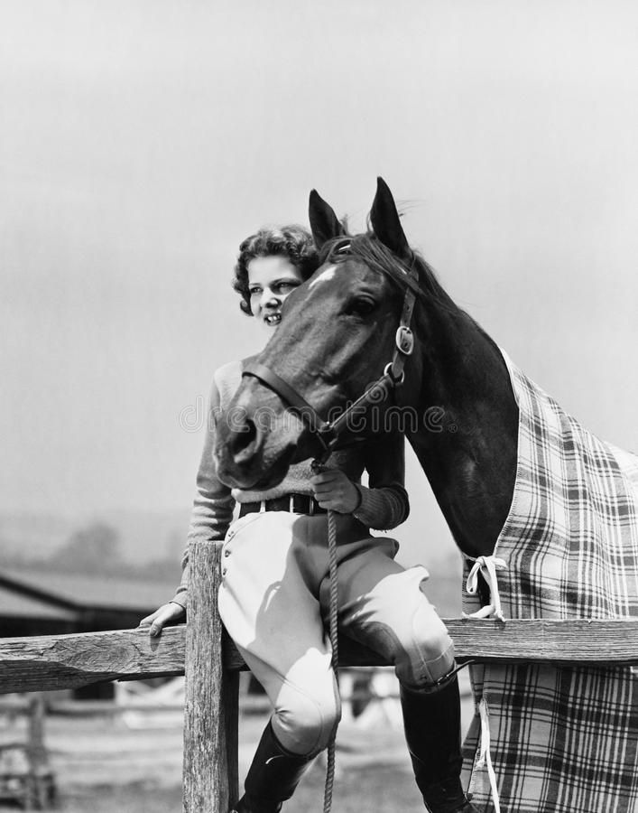 Portrait of woman with horse stock images