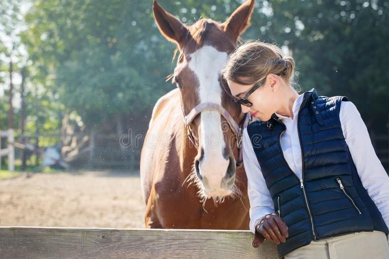 Portrait of a woman and horse. Young beautiful woman communicates with a horse stock image