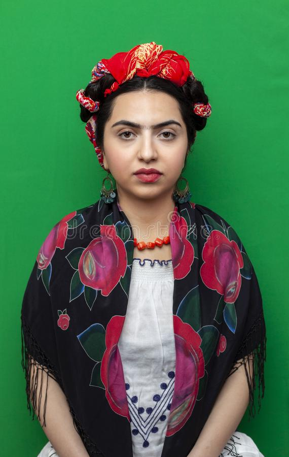 Portrait of a woman in the image of Frida Kahlo royalty free stock photography
