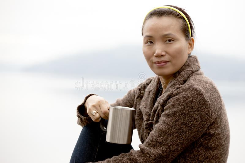 Portrait of woman by lake. royalty free stock photos
