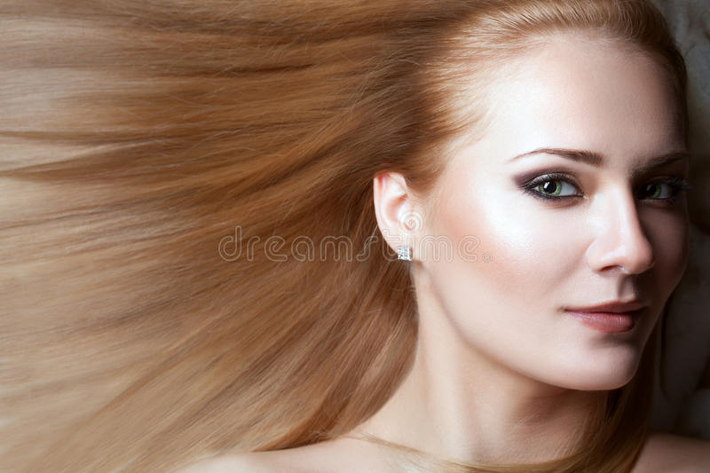 Portrait of a woman with long hair. stock photo