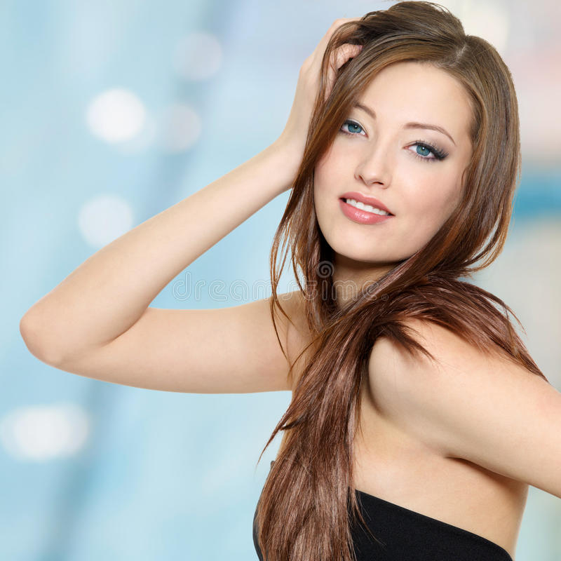 Portrait of woman with long straight hair stock photography