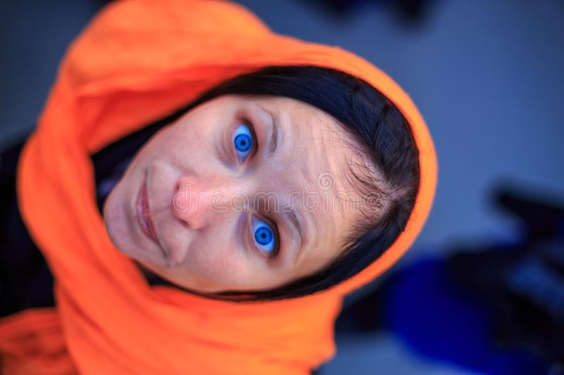 Portrait of a woman looking up with blue eyes stock photos