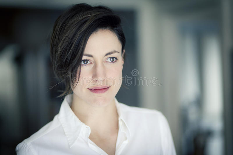 Portrait Of A Woman Lost In Thought stock images