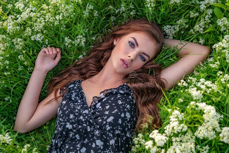 Portrait of a woman in natural white flowers stock photo