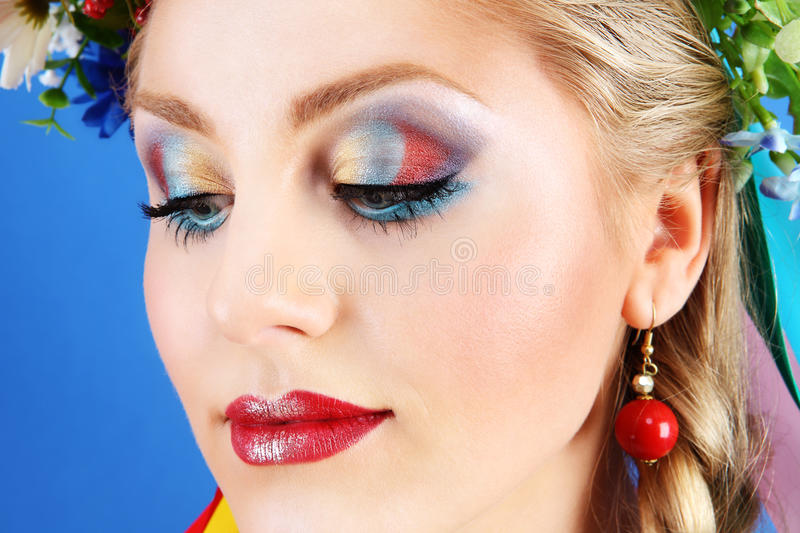 Portrait woman makeup with flowers on blue background stock images