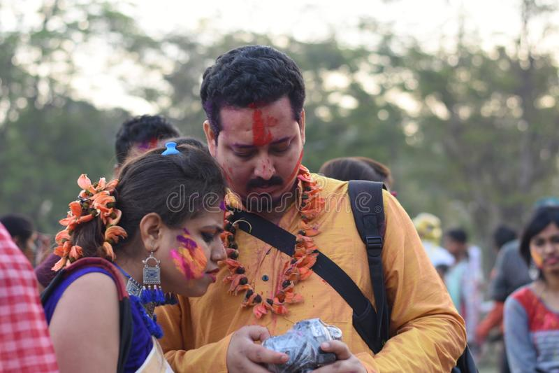 Portrait of a woman and man playing holi with colors and gulal royalty free stock photography