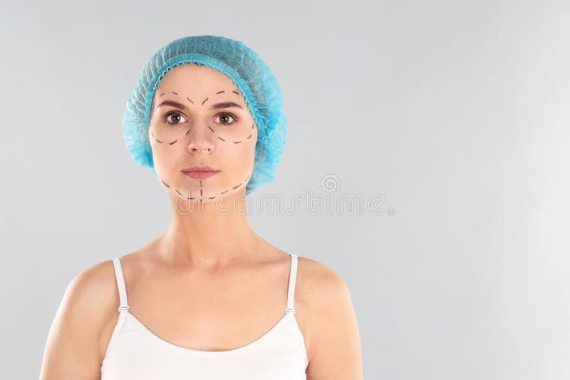 Portrait of woman with marks on face against grey background, space for text. Cosmetic stock photography
