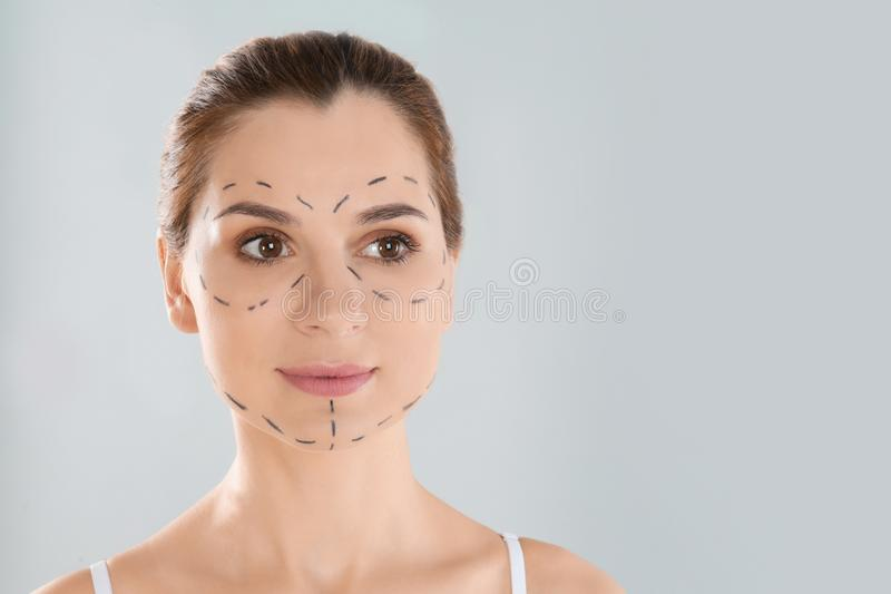 Portrait of woman with marks on face against grey background, space for text. Cosmetic royalty free stock image