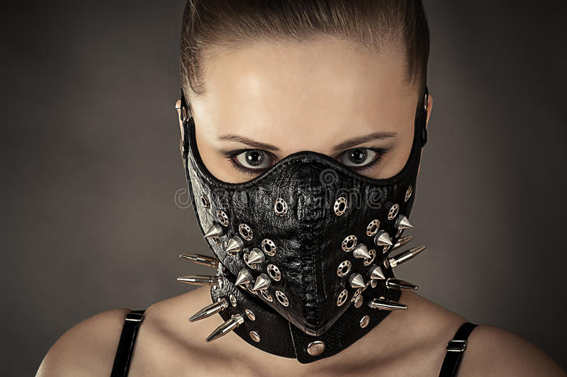 Portrait of a woman in a mask with spikes stock images