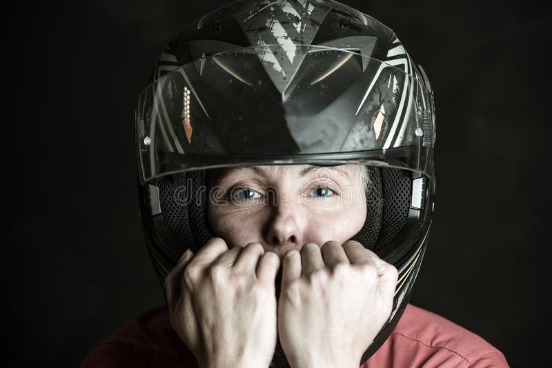 Danger and adrenaline are my name - portrait of a woman in a motorcycle helmet. Portrait of a woman in a motorcycle helmet, danger and adrenaline are my name royalty free stock photos
