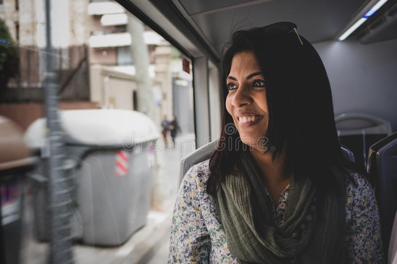 Portrait of a woman in a moving bus. stock photos