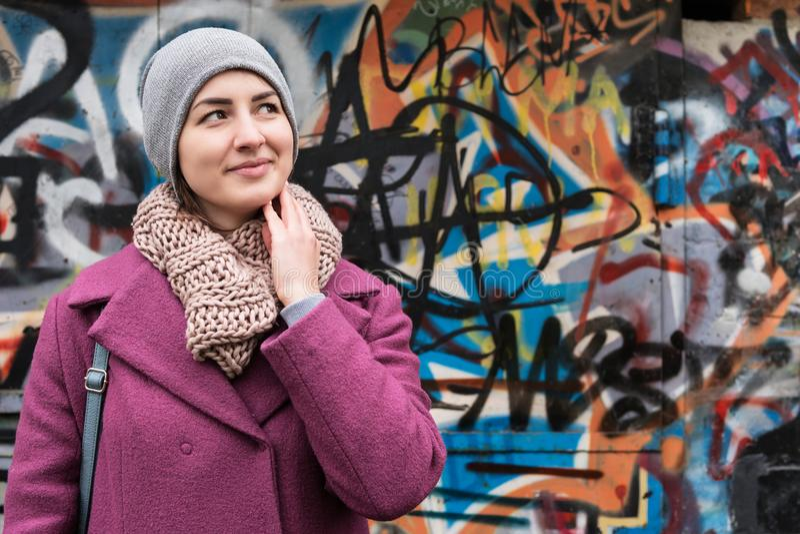 Portrait woman near the wall with graffiti stock photo