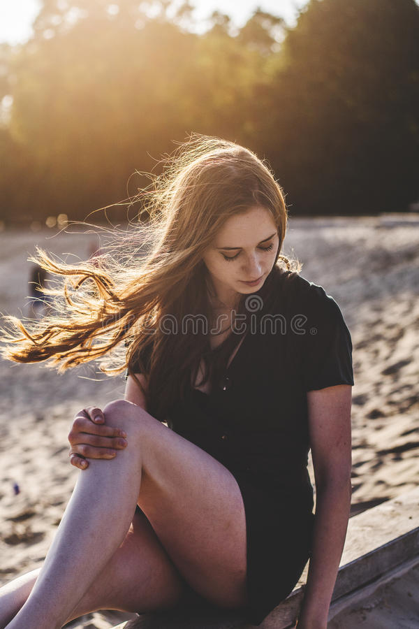 Portrait of woman outdoors on boardwalk stock images