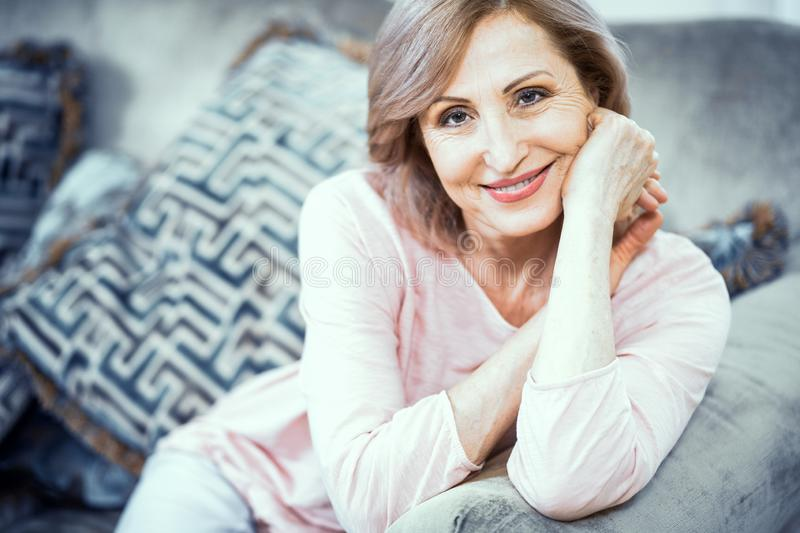 Portrait of a Woman Over 50 Who is Resting at Home in the Living Room. royalty free stock photography