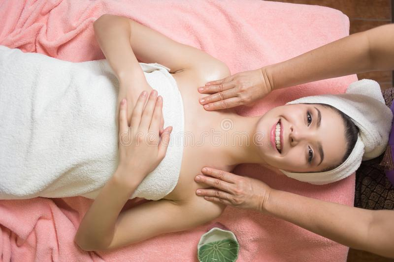 Portrait of woman patient in ayurveda spa wellness center lying relaxed royalty free stock image