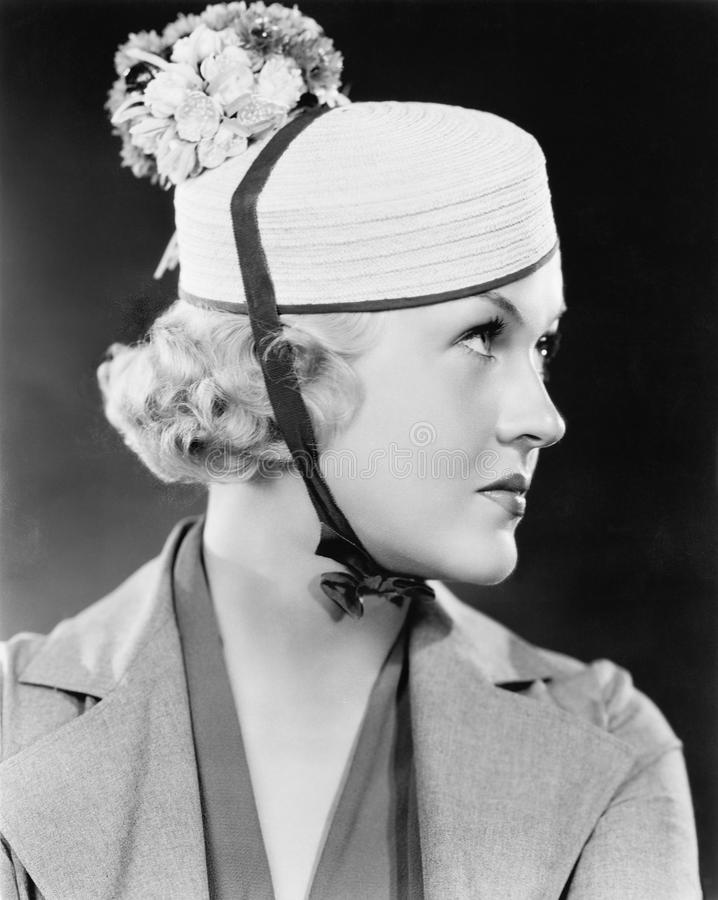 Portrait of a woman with a pillbox hat stock images