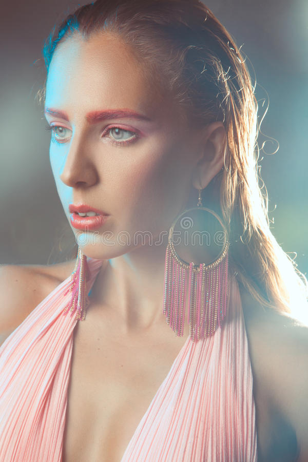 Portrait of woman with pink make up in haze