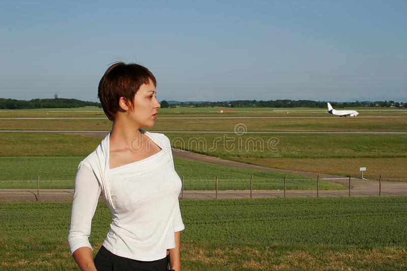 Portrait of woman with a plane stock photography