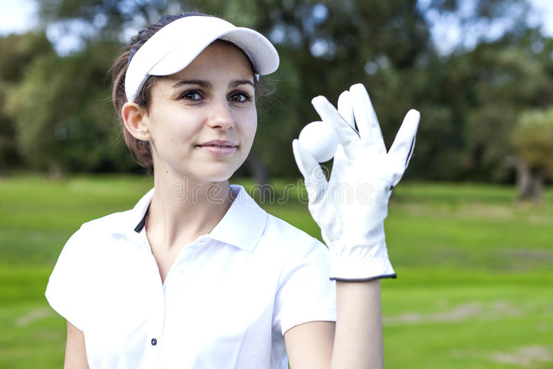 Portrait of a woman playing golf stock image
