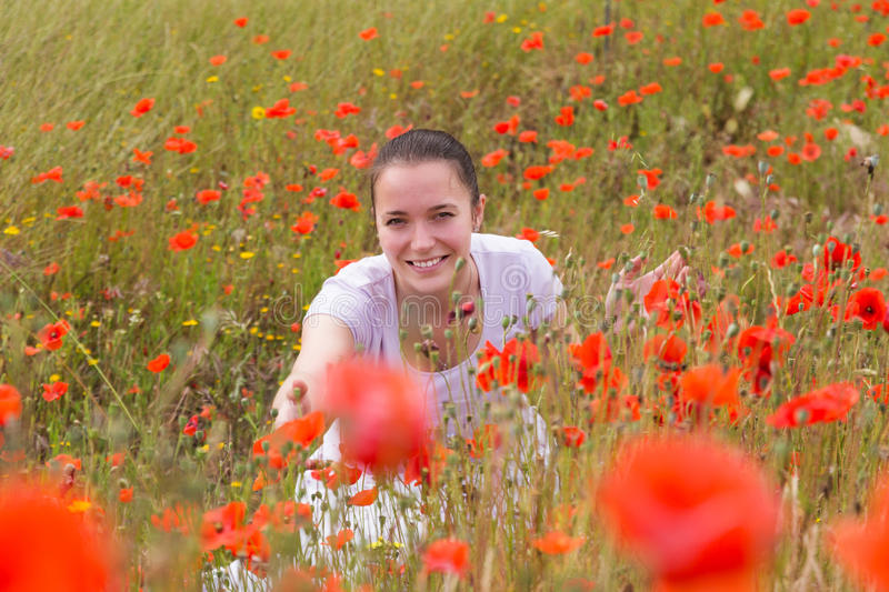 Portrait of woman in poppies royalty free stock photos