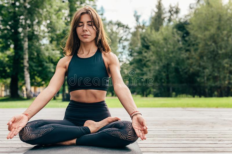 Portrait of a woman practicing yoga and meditating stock image