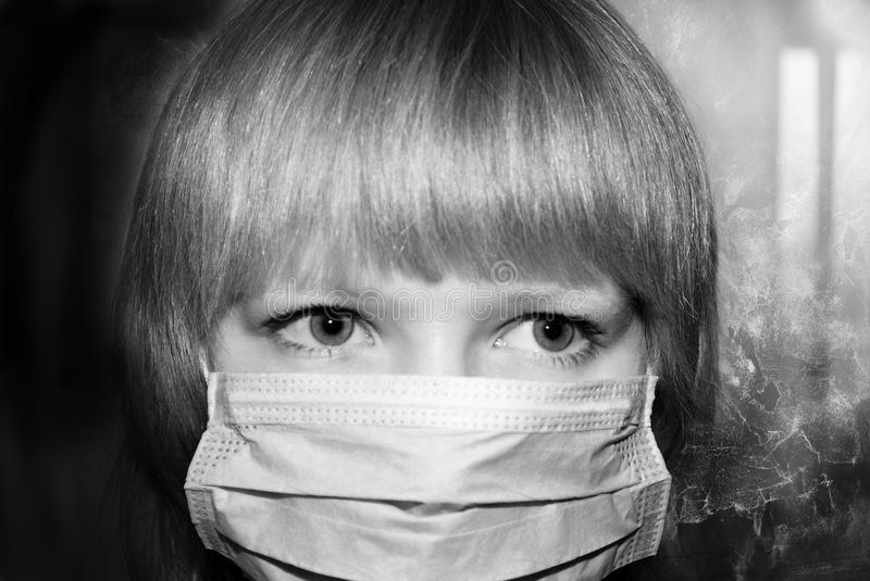 Portrait of woman in a protective mask stock photography