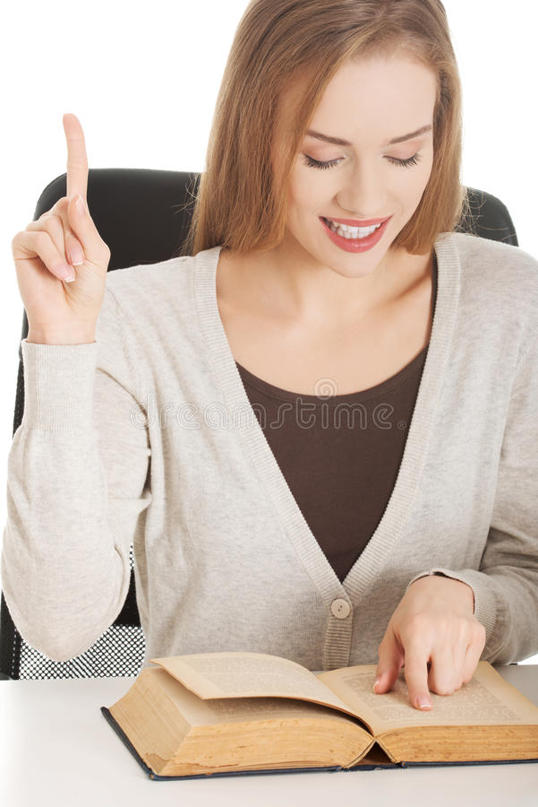 Portrait of a woman reading book stock images