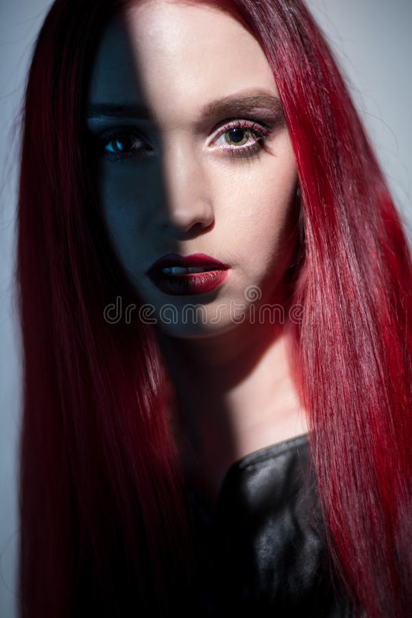 Portrait of woman with red hair and glitter make up stock photo