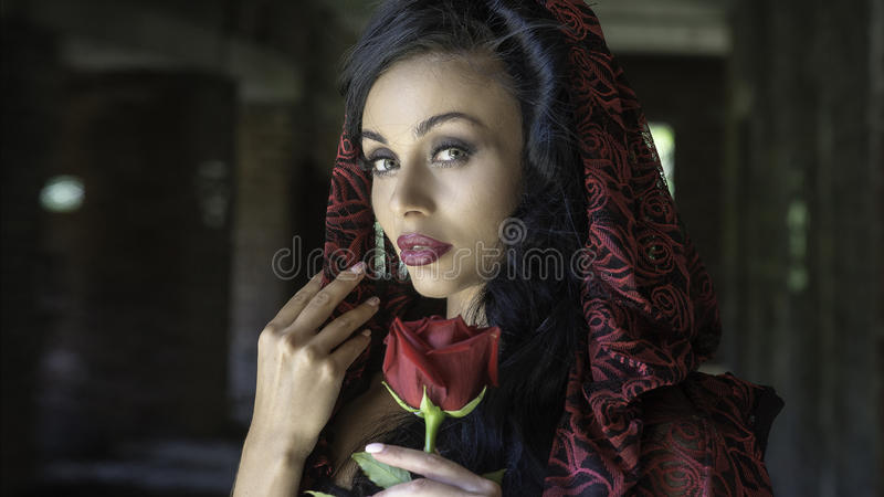 Portrait of woman with a rose royalty free stock image