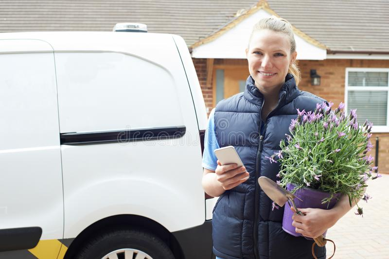 Portrait Of Woman Running Mobile Gardening Business Using Mobile. Woman Running Mobile Gardening Business Using Mobile Phone stock photos