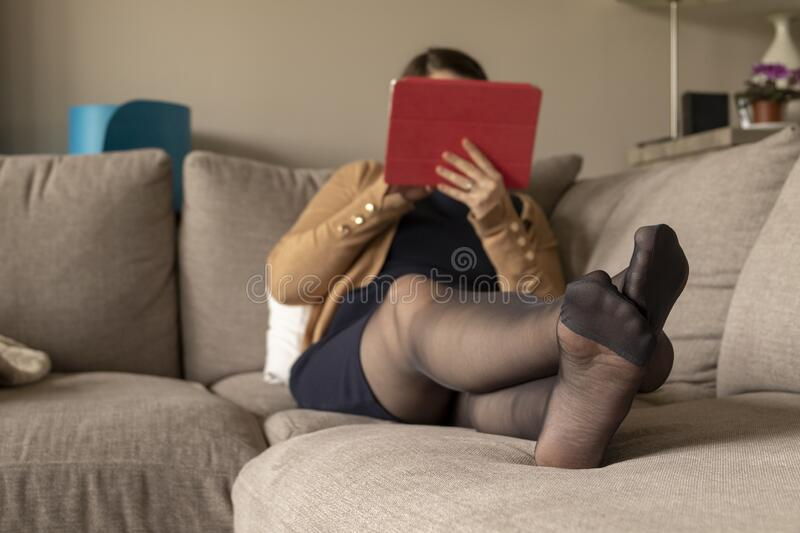 A Portrait Of A Woman S Pantyhose Feet While She Is Resting And Relaxing In The Couch With A Blanket And Using Her Tablet Stock Photo Image Of Living Adult 171994128