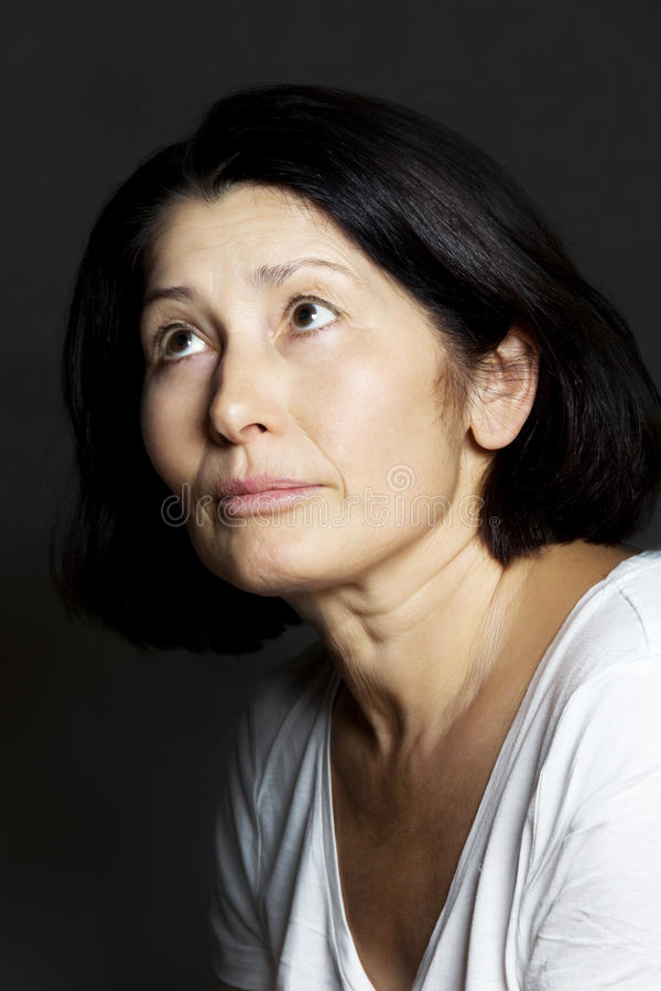 Portrait of the woman. Portrait of senior woman asian appearance on a black background stock image