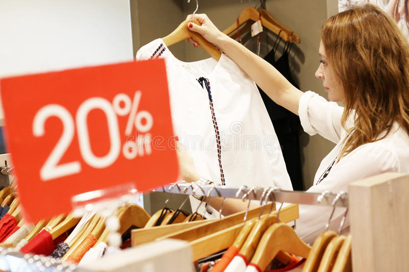 Portrait of woman in shopping center stock photos