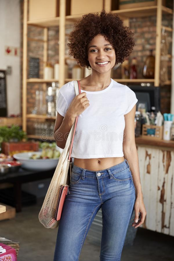Portrait Of Woman Shopping In Sustainable Plastic Free Grocery Store royalty free stock image