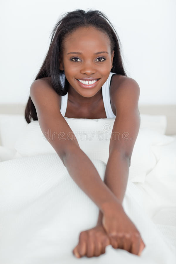 Download Portrait Of A Woman Sitting On Her Bed Stock Photo - Image: 22048606