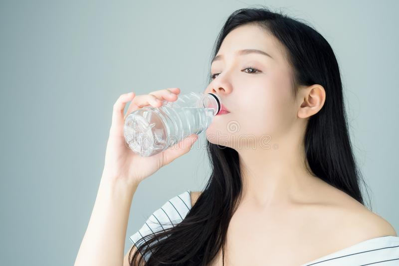 Portrait of woman skin beauty and health, Drinking water from a clean bottle. The skin is smooth and beautiful. stock images