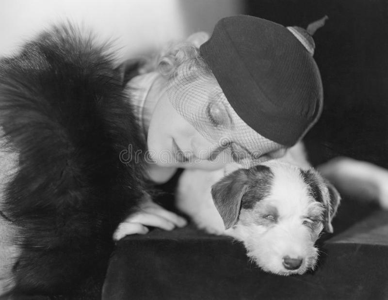 Portrait of woman with sleeping dog. (All persons depicted are no longer living and no estate exists. Supplier grants that there will be no model release issues royalty free stock image