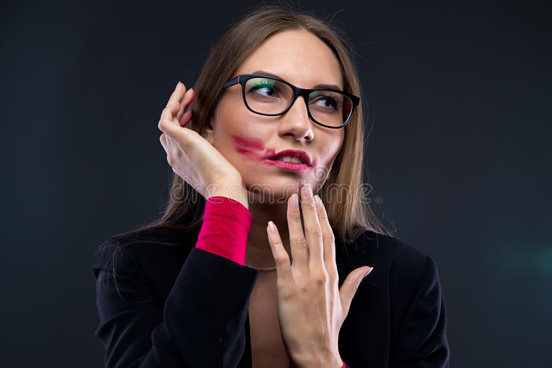 Portrait of woman with smudged red lipstick royalty free stock image