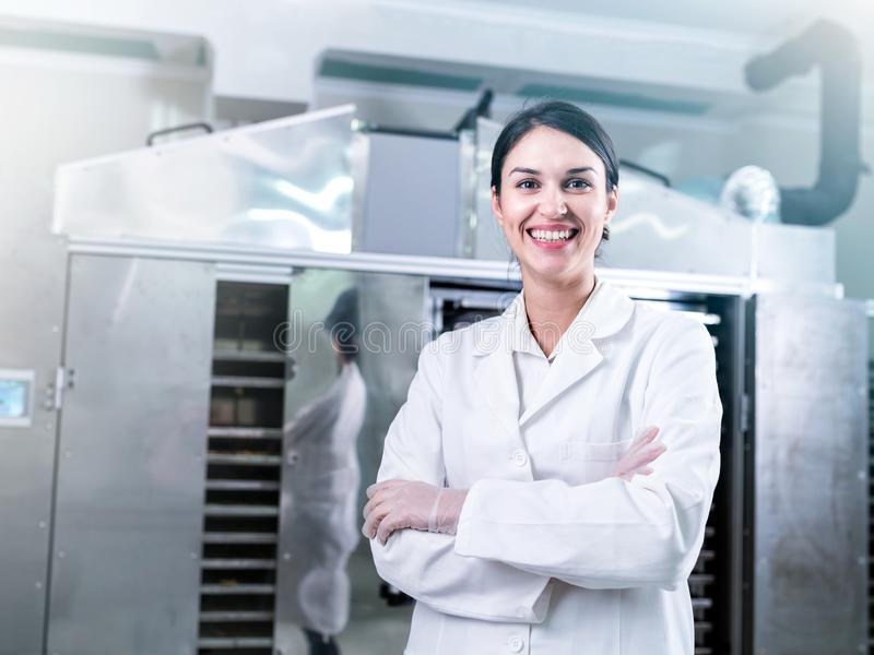 Female engineer in front of Food Dryer Dehydrator Machine stock photo