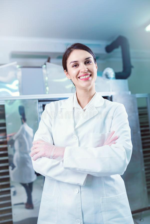 Female engineer in front of Food Dryer Dehydrator Machine stock photos