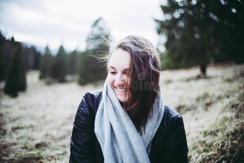 Portrait of woman in sunny forest stock photo